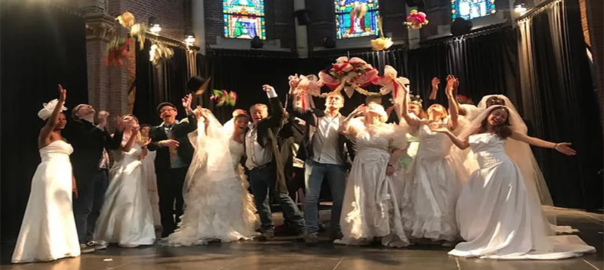 """Tourists getting """"married"""" for a day in Amsterdam."""