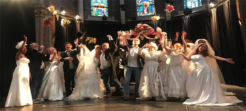 "Tourists getting ""married"" for a day in Amsterdam."
