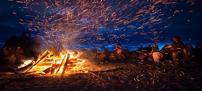 Nighttime beach bonfire